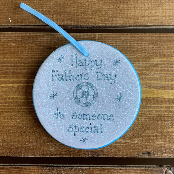 Handmade and hand painted ceramic hanging decoration with handwritten message:  'Happy Father's Day to someone special'  The decoration is finished with glitter covering.