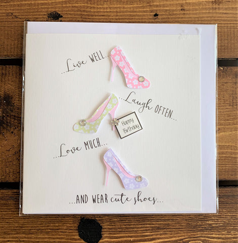 Hand finished birthday card featuring embellished shoes design which reads:  'Live well...Laugh often... Love much ... and wear cute shoes ....'