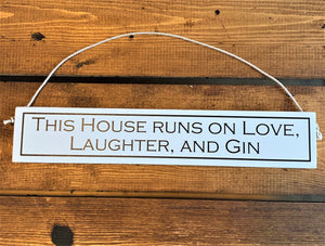 Hanging Wooden hand painted sign - this house runs on love, laughter and gin