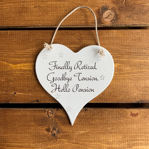 Hanging wooden heart - hand painted with the printed slogan:  'Finally Retired, Goodbye Tension, Hello Pension'