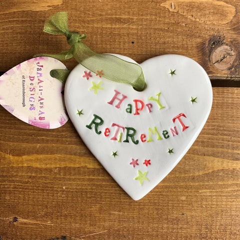 Hand painted ceramic heart featuring stars design and the sentiment 'Happy Retirement'