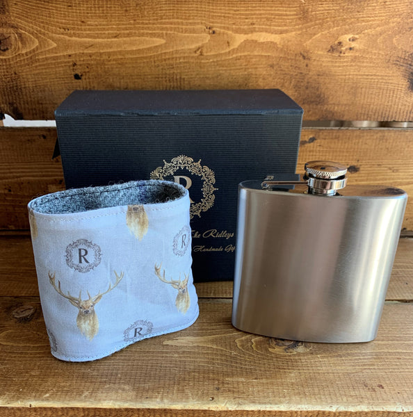 Harris Tweed Hip flask  6oz stainless steel hip flask which comes with a removable Harris Tweed sleeve which is fully lined in a bespoke stag fabric