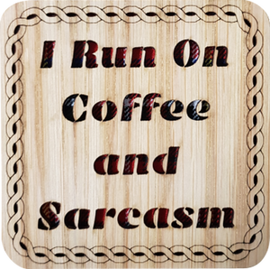 Wooden coaster with tartan insert and cut out text:  'I run on coffee and sarcasm'