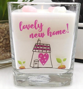 This gorgeous scented square jar candle features the message 'Lovely New Home'. Beautifully finished with small wax hearts on top and presented in its very own gift box.