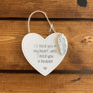 Hanging wooden heart with wooden feather and the printed sentiment:  'I'll hold you in my heart until I hold you in heaven'