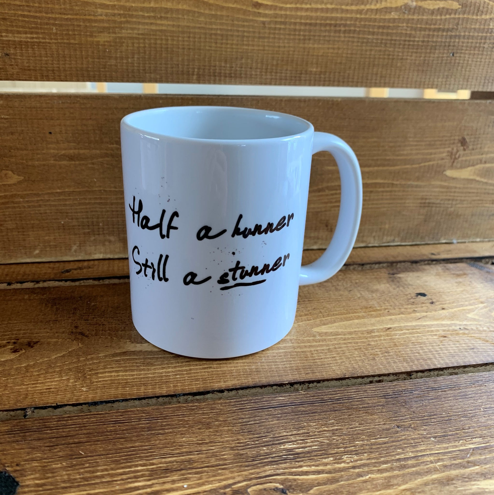 Monochrome Mug with '50' on one side and a hilarious Scottish slang poem on the reverse which reads:  'Half a hunner, still a stunner'