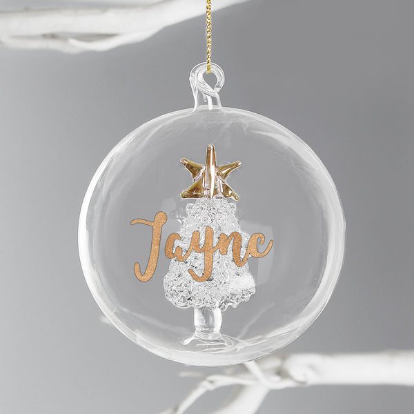 Beautiful personalised Christmas Tree decoration, with pretty gold glitter name.  Spread some Christmas cheer to family and friends with a sparkly Christmas memento this year.   The bauble can be personalised with a name up to 11 characters.  Dimensions: 8cm x 8cm x 8cm