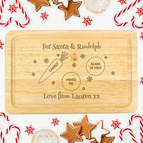 Santa and Rudolph's wooden Christmas Eve treat board is the perfect way to get the children ready for Santa this Christmas Eve.    Beautifully engraved words 'For Santa & Rudolph', 'CARROT', 'GLASS OF MILK' and 'MINCE PIE' are fixed text.
