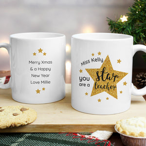 Personalised Star Teacher Mug with pretty star design, a wonderful gift to show all the hard working teachers your appreciation.  This mug can be personalised witha name up to 15 characters on the front and a message with up to 4 lines, 15 characters per line on the reverse.  The words 'You are a star teacher' are fixed text.