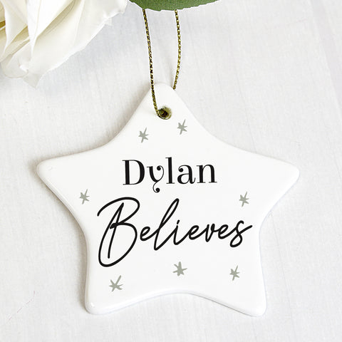 Beautiful personalised ceramic star Christmas decoration, with cute sentiment 'believes'. as fixed text. Perfect gift for the children this Christmas.   Personalise your bauble with any name upto12 characters long.