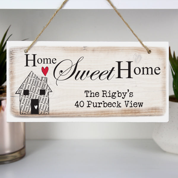 Wooden Hanging plaque which can be personalised with any message over two lines of 30 characters. 'Home Sweet Home' is fixed text.