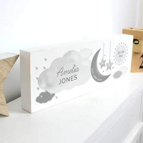Adorable personalised moon & stars wooden block decoration, a fabulous way of welcoming a new baby to the world.  This sign can be personalised with a first name with 12 characters which is case sensitive and surname with 12 characters which is fixed upper case (on cloud). Date: 20 characters (on moon) Fixed upper case. Weight:  4 characters (on left star) and 4 characters (on right star) Case sensitive. Time : 5 Characters (on sun) with AM/PM Fixed upper case.