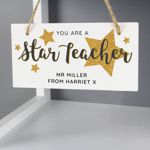Beautiful wooden hanging sign 'Star Teacher' would make a lovely gift for all the teachers out there.  Personalise this decoration with a name up to 20 characters long and a message with up to 20 character. 'You are a star teacher' is fixed text and cannot be changed.  The personalisation will appear in fixed upper case.