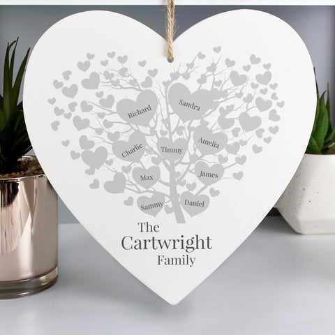 Wooden Hanging Heart with beautiful family tree design which can be personalised with  up to 9 family members.  Personalise with family surname up to 20 Characters and names (1 to 9) up to 12 characters per name. The text will appear as entered.