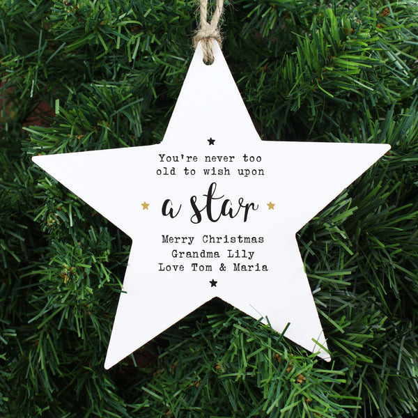 ***Price includes delivery***  Beautiful personalised wooden star hanging decoration, with cute sentiment  'You're never too old to wish upon a star'. as fixed text.   This would make a lovely gift all year round but also perfect for Christmas!  Personalise your star with 3 lines of 20 characters available per line.  Comes with ribbon, ready to hang, (ribbon colour may vary)