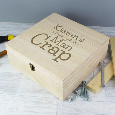 Quirky wooden keepsake box to keep his clutter at bay featuring a metal clasp and hinges. The box can be personalised with a name up to 12 characters long and will appear as entered.  It has the fixed text:  'box of man crap'
