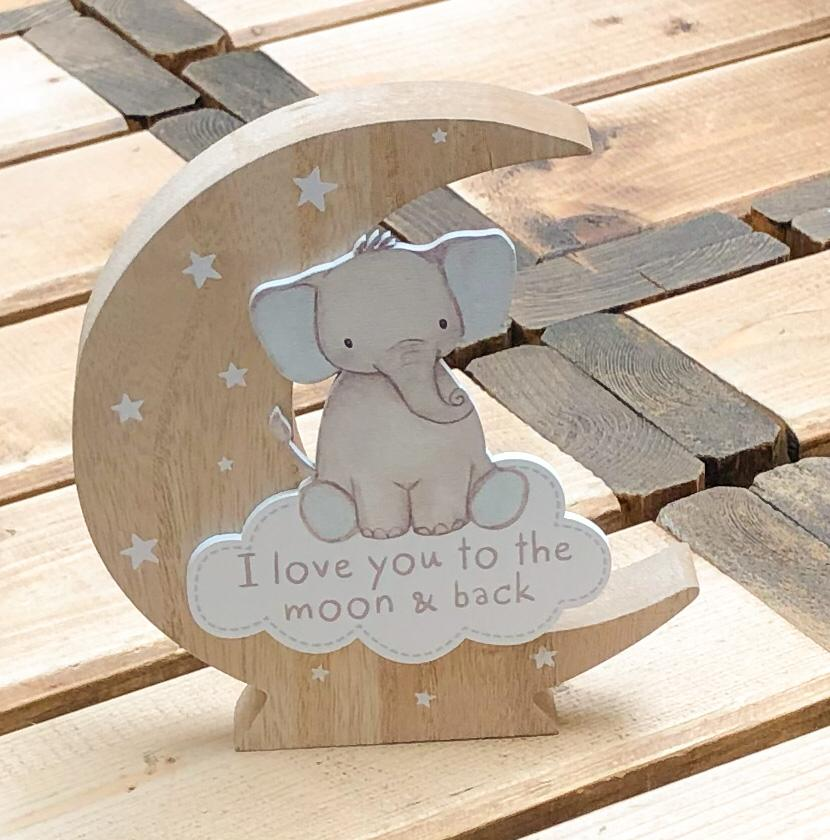 Richard Lang Derby wooden moon block.  Decorated with cute baby elephants sitting on the starry moon with text which reads:  'I love you to the moon and back'
