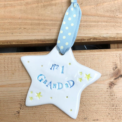 Hand painted ceramic star featuring star design and the sentiment 'No1 Grandad' Handmade in the UK using clay, glaze and paint sourced locally.