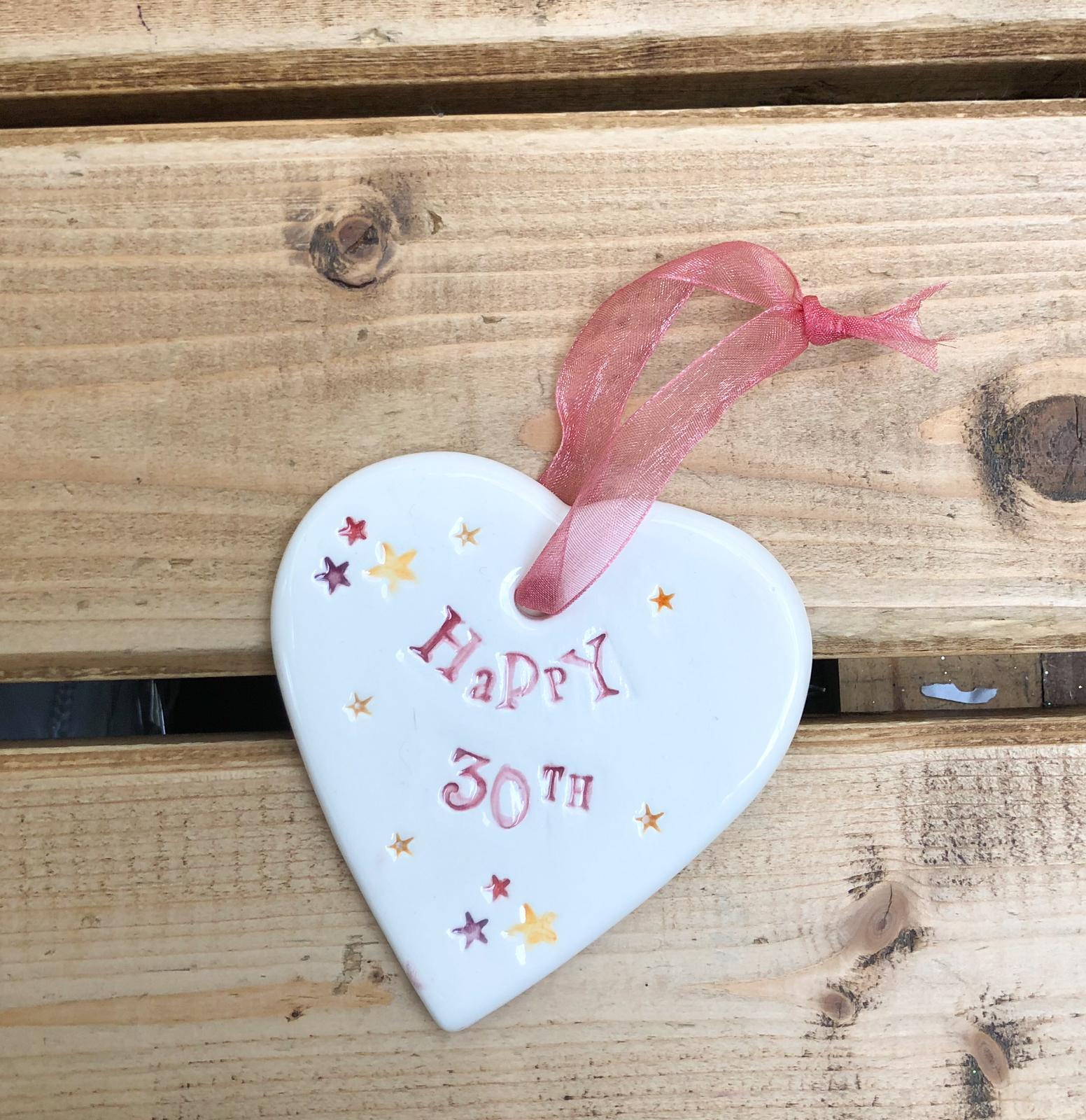 Hand painted ceramic heart featuring star design and the sentiment 'Happy 30th'  Handmade in the UK using clay, glaze and paint sourced locally.  Material:  Ceramic
