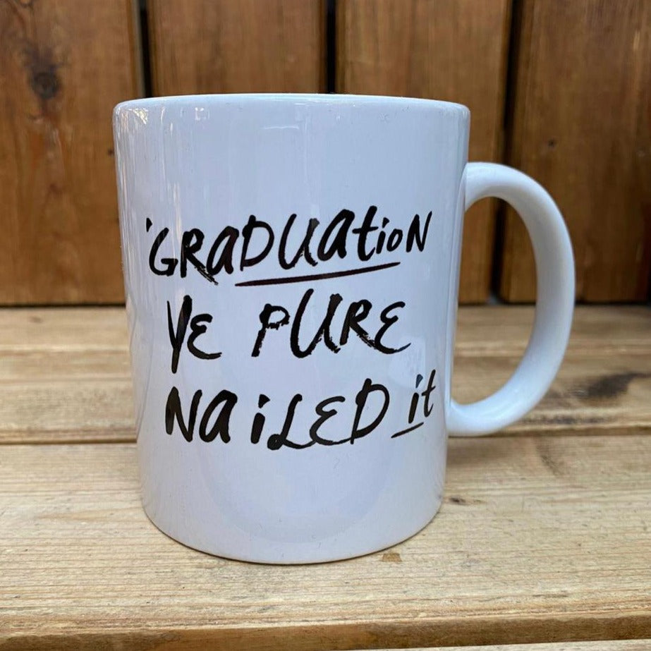 Mug with the Scottish slogan 'Graduation, Ye pure nailed it' ......The perfect gift for that graduate with a sense of humour .  Other variations available.  Printed in Glasgow.