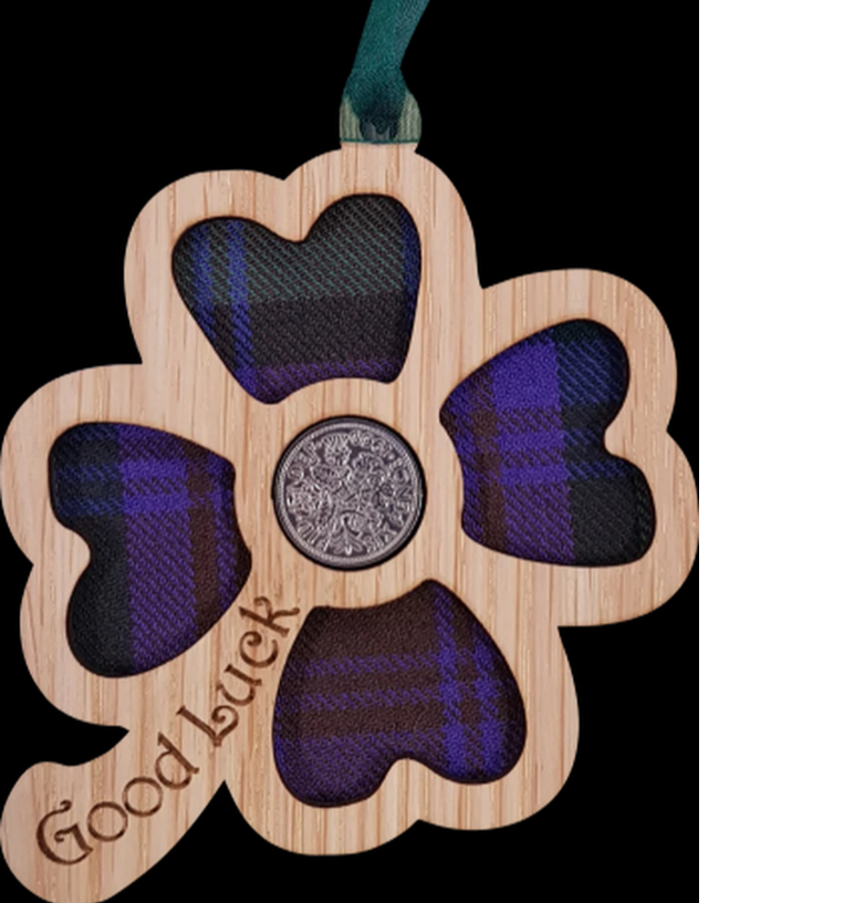 A unique keepsake gift with a Scottish twist.  The sixpence is mounted onto a hanging oak veneered wooden clover with tartan inserts, mounted on card and packaged in clear cellophane packets.  A lucky sixpence is traditionally believed to bring good luck with some families passing down the same sixpence through generations.