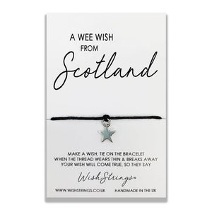 Wishstring 'wish' bracelet featuring Tibetan Silver star charm hand strung on quality waxed cotton cord.    This 'Scotland' Wishstring is presented on a display card with the sentiment:  'A wee wish from Scotland'