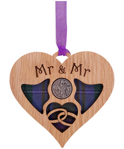 A unique keepsake gift with a Scottish twist.  The sixpence is mounted onto hanging oak veneered wooden heart with tartan inserts, mounted on card and packaged in clear cellophane packets.  The sentiment 'Mr & Mr' is engraved across the heart.
