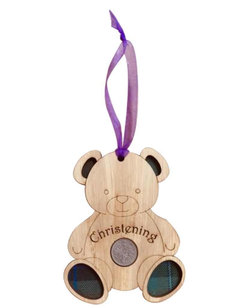 A unique keepsake christening gift with a Scottish twist.  The sixpence is mounted onto an oak veneered wooden teddy with tartan inserts, mounted on card and packaged in clear cellophane packets.