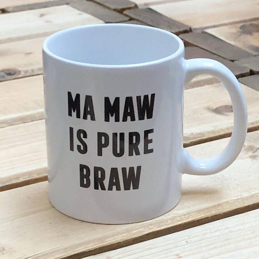 This mug with the Scottish slogan 'Ma Maw is Pure Braw' is the perfect gift for many occasions.  Printed in Glasgow.