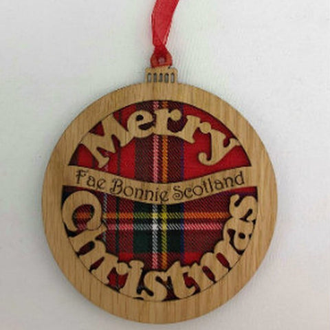 A unique keepsake Christmas decoration with a Scottish twist.  A wooden Christmas Bauble with tartan inserts and the sweet sentiment 'Merry Christmas fae Bonnie Scotland', mounted on card and packaged in clear cellophane packets.