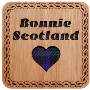 Wooden coaster with tartan insert, cut out heart and and cut out text:  'Bonnie Scotland'