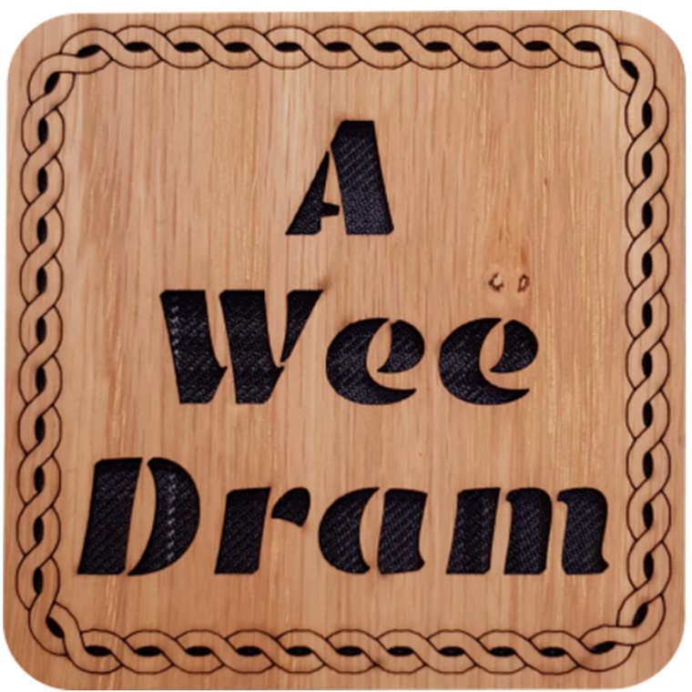 Wooden coaster with tartan insert and cut out text:  'A Wee Dram'