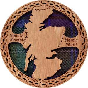 Round wooden coaster with tartan insert and cut out map of Scotland.  The coaster features the inscription:  'Slainte Mhath!' and 'Slainte Mhor!' meaning 'Good Health!' 'Great Health!'