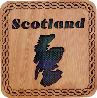 Wooden coaster with tartan insert and cut out map of Scotland.