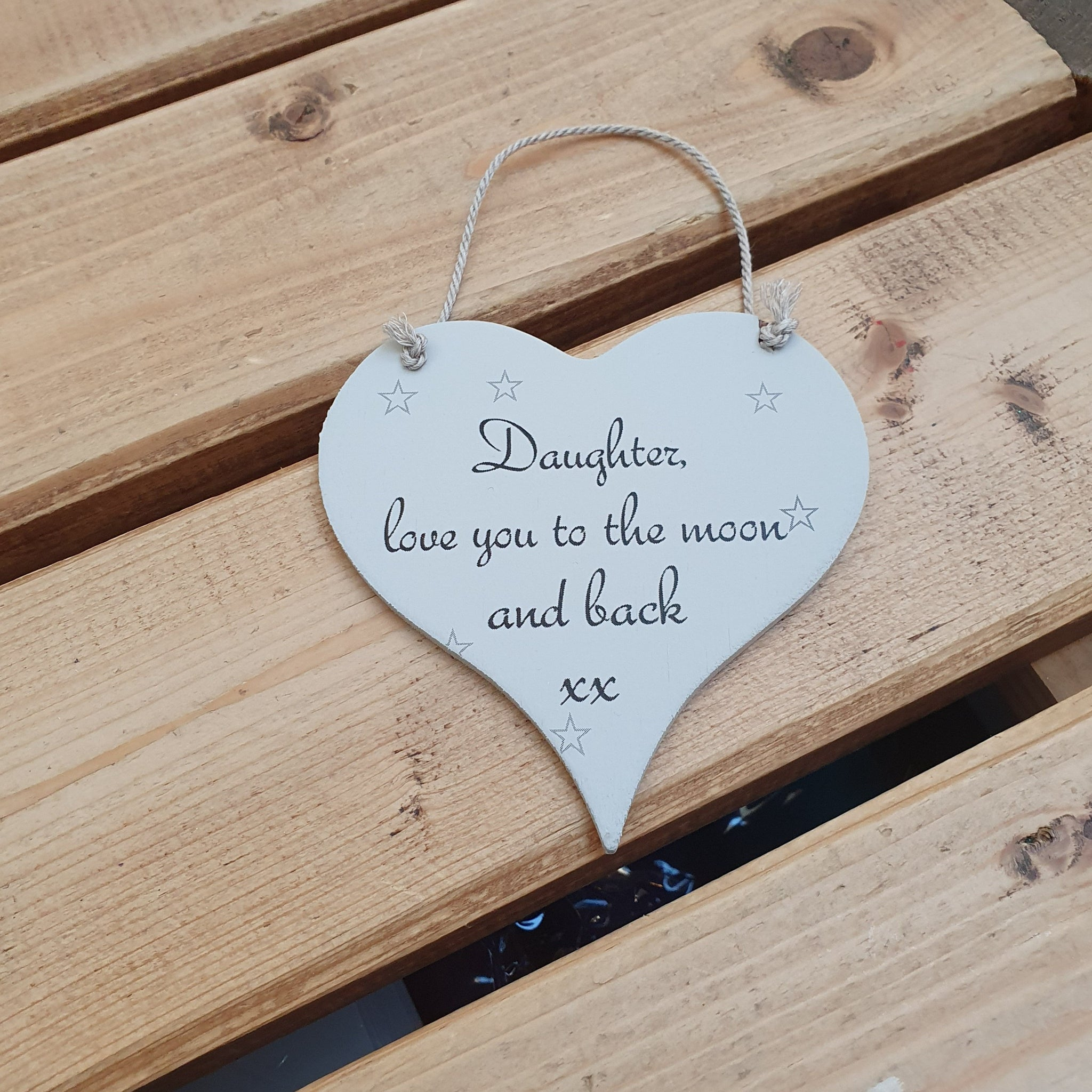 Hanging wooden heart - hand painted with the printed slogan:  'Daughter, Love you to the moon and back.'