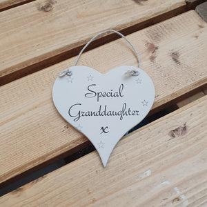 Hanging wooden heart - hand painted with the printed slogan:  'Special Granddaughter'