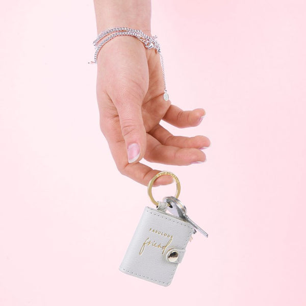 This Beautifully Boxed photo keyring from much loved brand Katie Loxton comes in a grey colour with the sweet sentiment  'fabulous friend' engraved in gold. Featuring a luxe gold side snap closure opening to your chosen photograph.