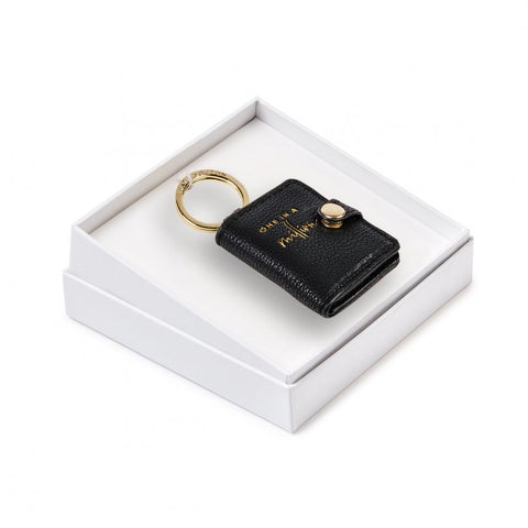 This Beautifully Boxed photo keyring from much loved brand Katie Loxton comes in a stunning black with the sweet sentiment  'One in a million' engraved in gold. Featuring a luxe gold side snap closure opening to your chosen photograph.