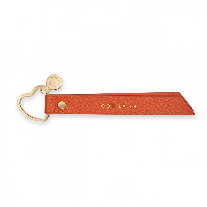 This Beautiful flag keyring from much loved brand Katie Loxton comes in a stunning burnt orange leather with the sweet sentiment  'ooh la la' engraved in gold. Featuring a luxe gold heart shaped key fob.