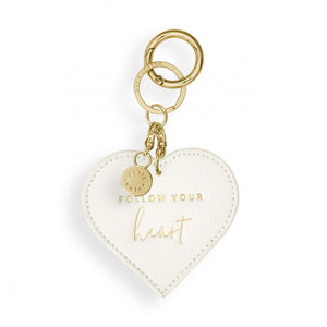 This beautiful chain keyring from much loved brand Katie Loxton comes in a stunning off white heart shape with the sweet sentiment  'Follow your heart' engraved in gold. Featuring a luxe gold tone key fob.