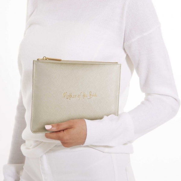 This eye catching Perfect Pouch from much loved brand Katie Loxton comes in a metallic gold colour with the added sentiment in gold, handwritten style 'Mother of the bride'.