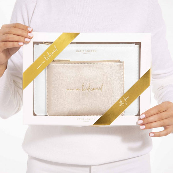 This stylish white set includes a metallic white coloured Perfect Pouch and pretty mini pouch with the handwritten sentiment 'Beautiful Bridesmaid' to make the perfect bridal party accessories.  The set comes presented in a gift box.
