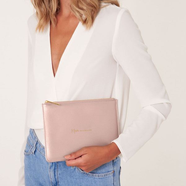 lifestyle image of Katie Loxton Perfect pouch mum in a million pale pink