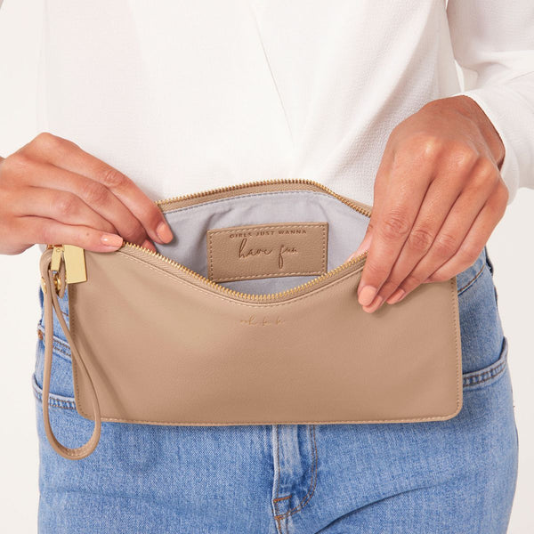 lifestyle image showing interior of Katie loxton secret message pouch Ooh la la Taupe