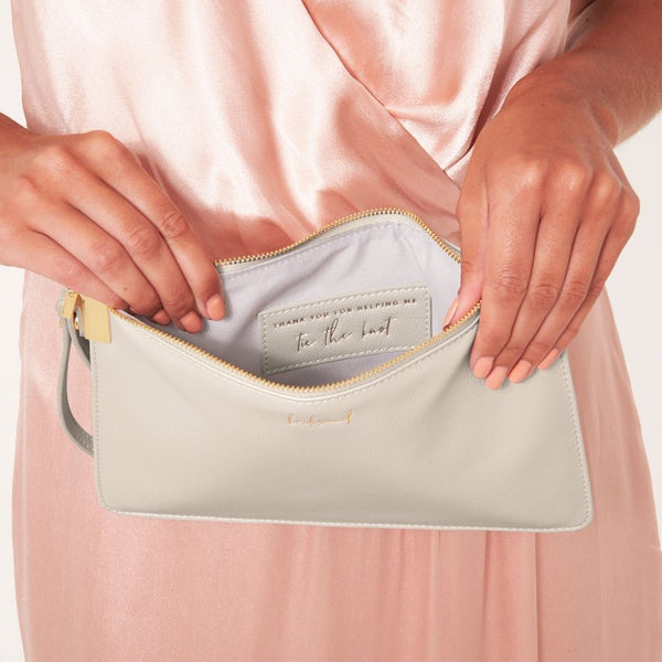 This eye catching Secret Message Pouch from much loved brand Katie Loxton comes in a stunning white colour with the word 'Bridesmaid' and the added sentiment in gold, handwritten style 'Thank you for helping us tie the knot' hidden inside.