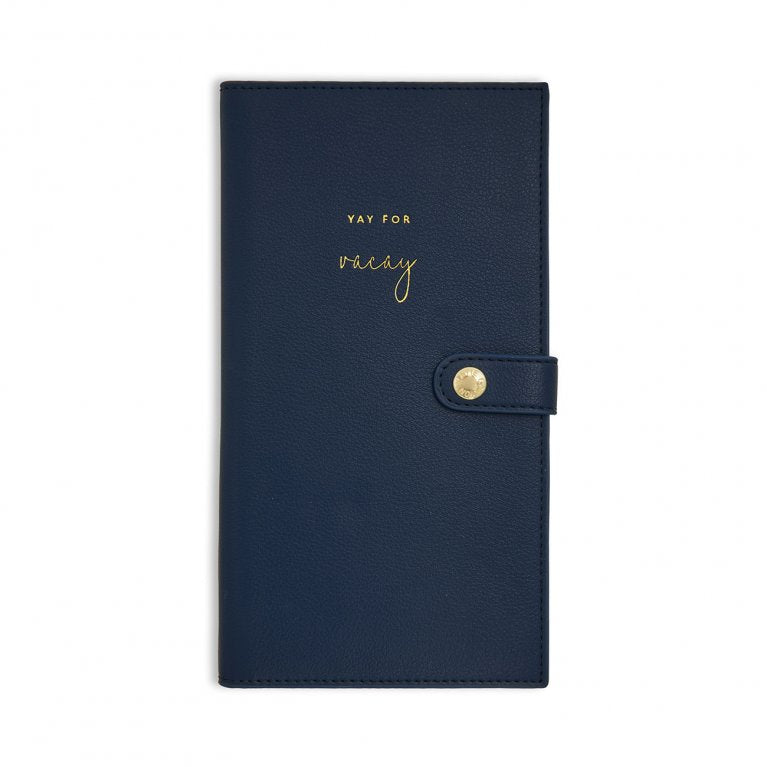 This stylish navy 'Yay for vacay' travel wallet for the chicest travel accessories. It has two compartments, one for your passport and one for your travel documents.  Finished beautifully with a golden press stud to close.