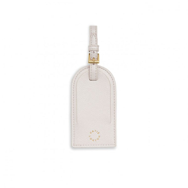 This stylish white 'Paradise Please' luggage tag for the chicest travel accessories. Beautifully designed with a gold-tone buckle and section to write your personal details.  Matching Items Available
