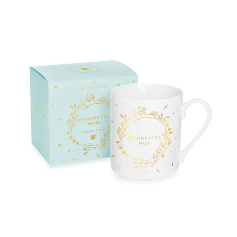 This pretty mug from Katie Loxton is finished with a beautiful floral wreath pattern around the sentiment 'Wonderful Mum', glowing in gold-foil for an added shining touch.  The mug comes beautifully gift boxed in a baby blue box