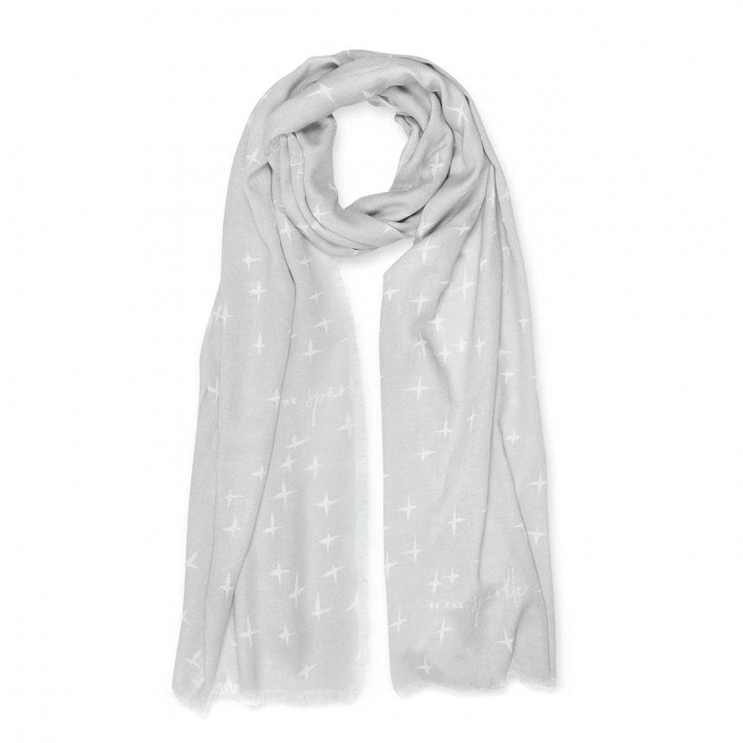 This Herringbone Weave sentiment scarf features a abstract sparkle print with the sentiment 'Be the sparkle' scattered throughout. Beautiful addition to your winter wardrobe.