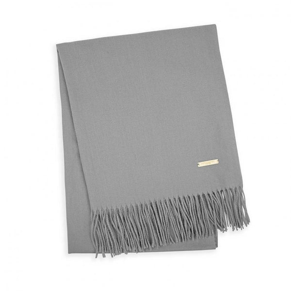 Beautifully soft, luxurious grey thick knit scarf by the loved brand Katie Loxton. Finished with tassel edging and a gold logo branded bar. Perfect addition to your  wardrobe season after season!  Presented in a lovely luxe gift box.